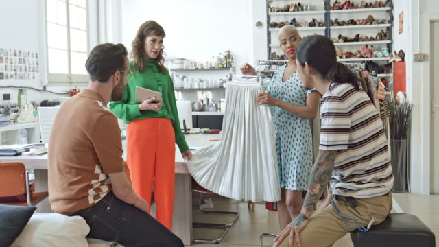 fashion designers discussing over dress in office - 30 39 years stock videos & royalty-free footage