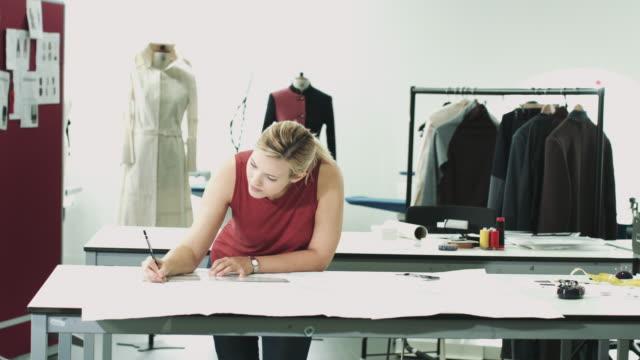 Fashion designers drawing in studio