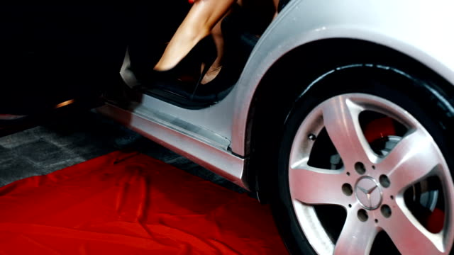 fashion female model stepping out of car - dress shoe stock videos and b-roll footage