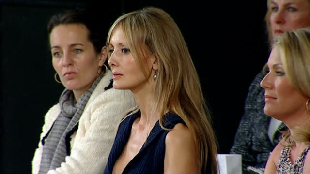 first chanel fashion show in london: backstage / catwalk show; spectators sat watching show / general view catwalk room / more of models parading... - fashion collection stock videos & royalty-free footage