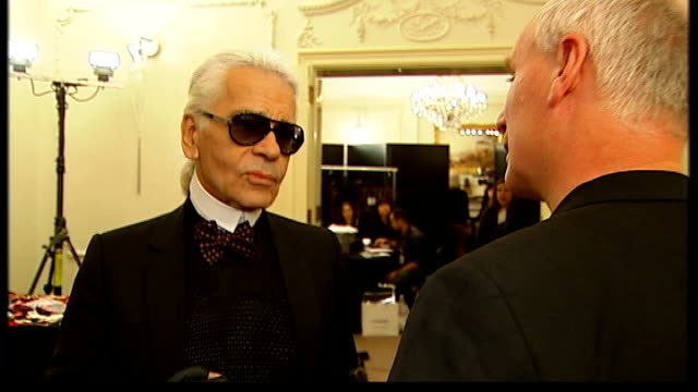first chanel fashion show in london england london mayfair nobu berkeley street karl lagerfeld interview sot on massaro / i think he liked shoes / he... - fetishism stock videos & royalty-free footage