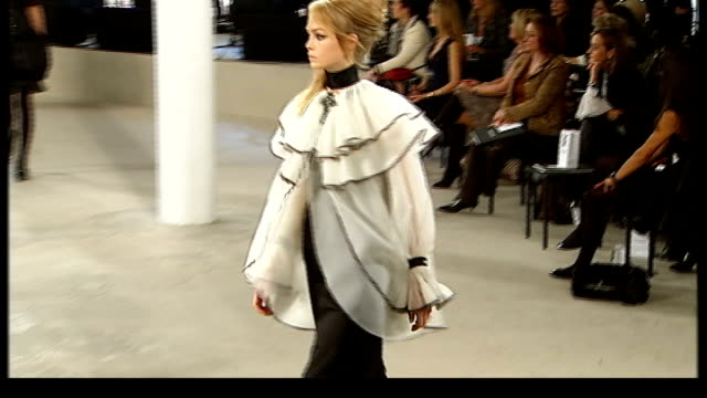 first chanel fashion show in london; models along catwalk including wearing white blouse with pierrot collar and huge wing sleeves over black skirt,... - black dress stock videos & royalty-free footage