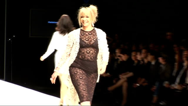 vídeos de stock, filmes e b-roll de fashion for relief show in aid of haitian earthquake victims james corden and david walliams hand in hand along down catwalk / corden and walliams... - cardigan blusa