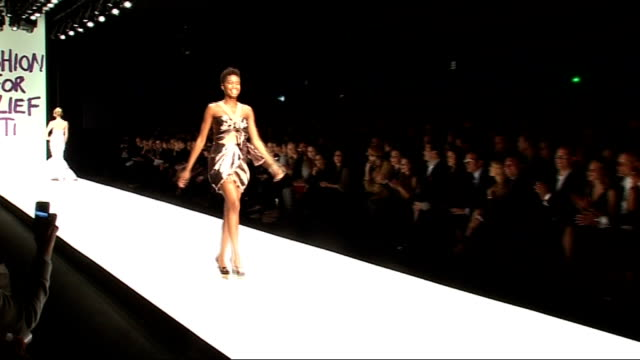stockvideo's en b-roll-footage met fashion for relief show in aid of haitian earthquake victims more of models on catwalk / model stumbling in high heels and nearly falling / model... - model gefabriceerd object
