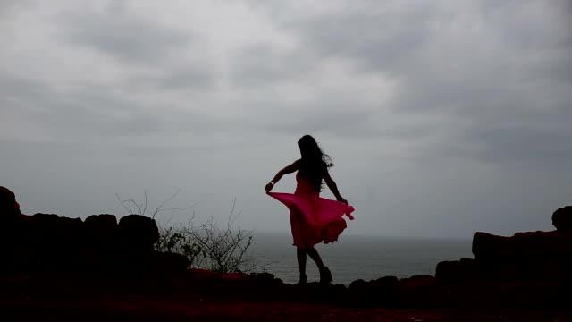 fashion girl standing near sea coastline - one teenage girl only stock videos & royalty-free footage