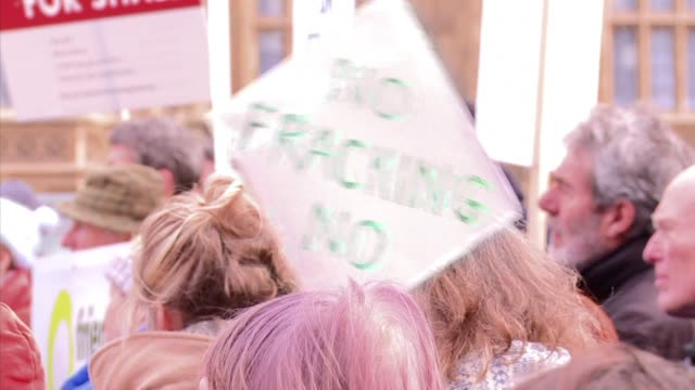 fashion icons vivenne westwood and bianca jagger attended a protest against fracking in londons parliament square on monday - westwood bildbanksvideor och videomaterial från bakom kulisserna