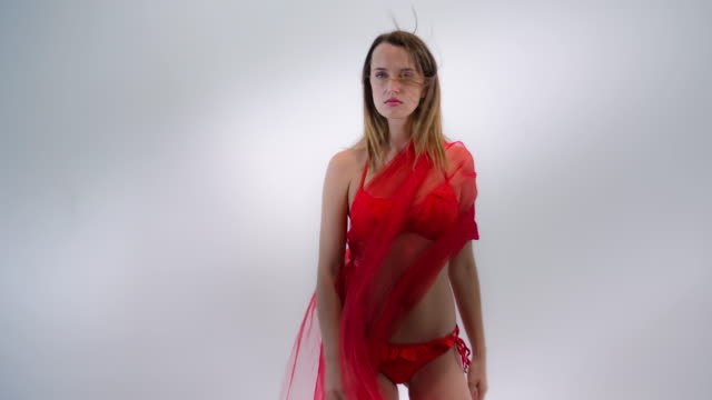 fashion model in bikini with flowing red fabric - swimwear stock videos and b-roll footage