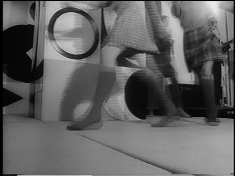 b/w 1966 fashion models' legs in kilts marching in fashion show / london / newsreel - anno 1966 video stock e b–roll
