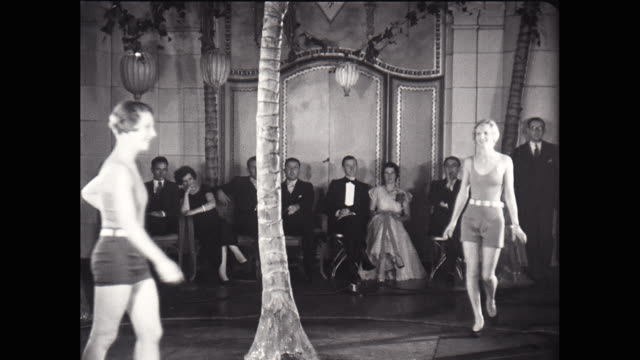 WS Fashion models walking during swimsuit fashion show / United States