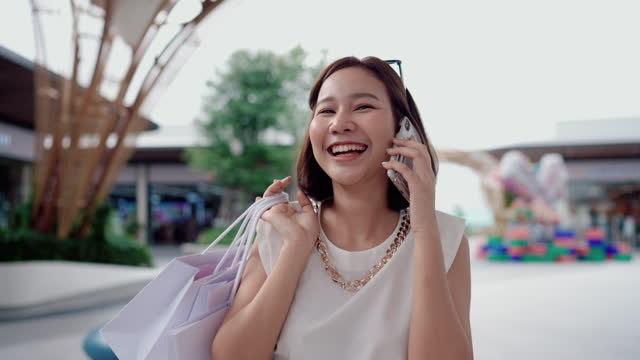 fashion people having fun in the community mall walking and holding her shopping bags - shopaholic stock videos & royalty-free footage