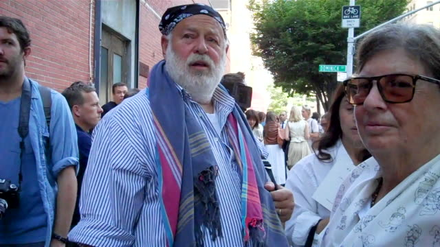 fashion photographer bruce weber and his wife nan bush a film producer arrive to a huge crowd before ralph lauren's fashion show she assures him well... - lauren bush lauren stock videos & royalty-free footage