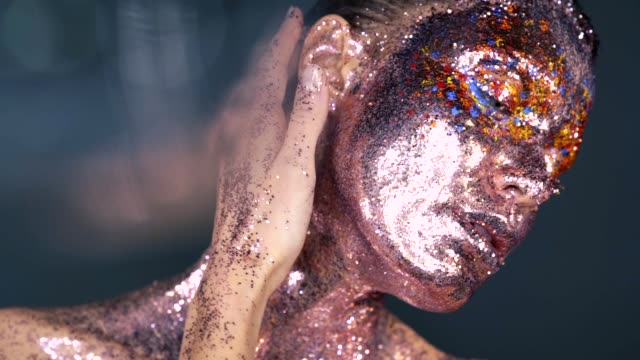 fashion portrait of woman with artistic colorful make-up - art stock videos & royalty-free footage