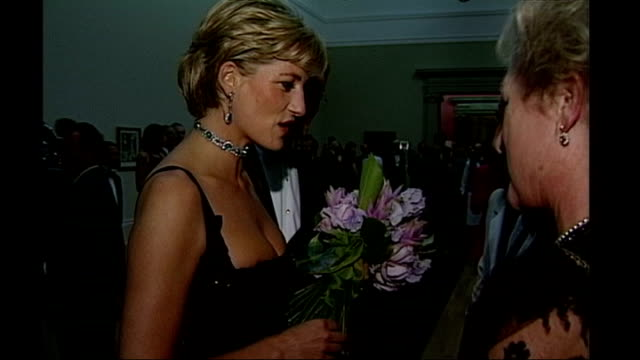 princess diana fashion show; 1997 tate gallery: **beware flash photography** princess diana, wearing black beaded evening dress and holding flowers,... - princess stock videos & royalty-free footage
