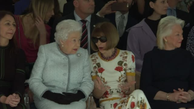Queen attends London Fashion Week ENGLAND London INT Various shots Queen Elizabeth II and Anna Wintour seated watching Richard Quinn runway show at...