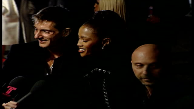 fashion rocks event red carpet arrivals england london the royal albert hall naomi campbell posing at photocall standing between designers dolce and... - royal albert hall stock videos and b-roll footage