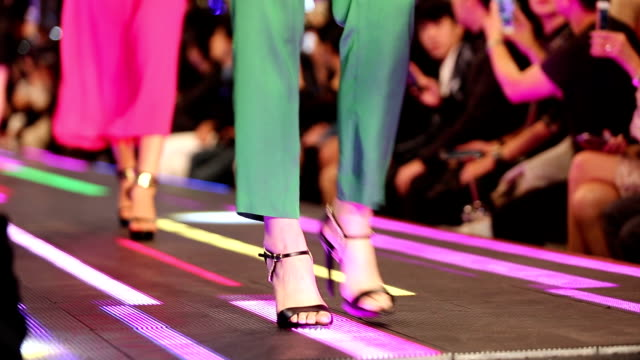 fashion show on led floor which has super model present shoes high heels - elevated walkway stock videos & royalty-free footage