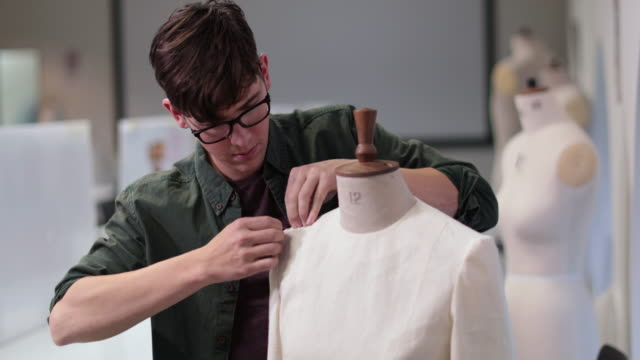 fashion student designing a garment - males stock videos & royalty-free footage
