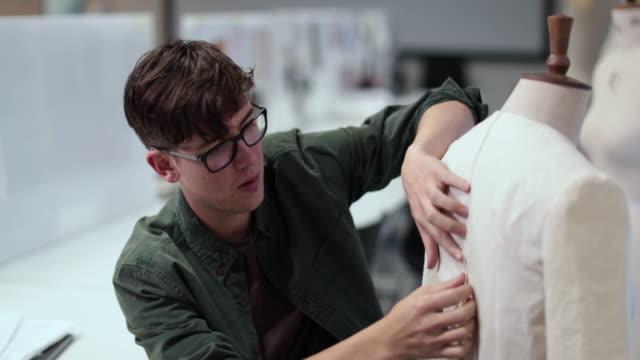 Fashion student designing a garment