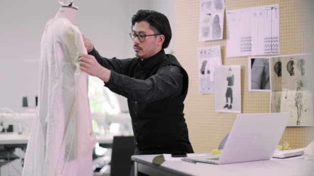 fashion student taking photo of design at college - fashion industry stock videos & royalty-free footage