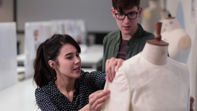 fashion students working on a design - トルソー点の映像素材/bロール