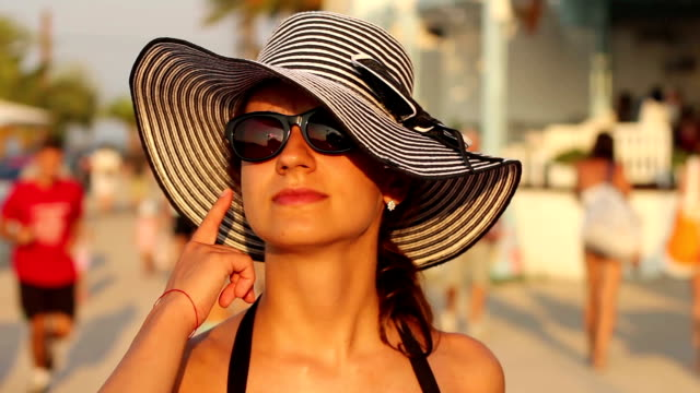 fashion style portrait of young trendy girl in fashionable hat and sunglasses
