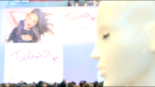 tulisa launches tfb clothing line england london shepherds bush westfield throughout*** cashiers at the popup shop / tfb collection signs / mannequin... - gymnastikanzug stock-videos und b-roll-filmmaterial