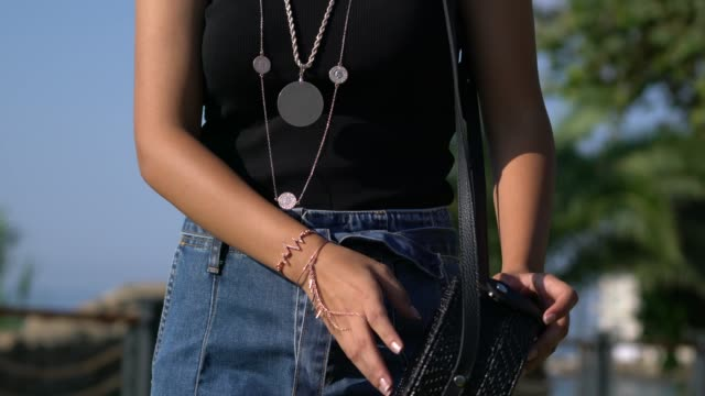 fashionable big black purse on the arm of the young women - borsetta video stock e b–roll