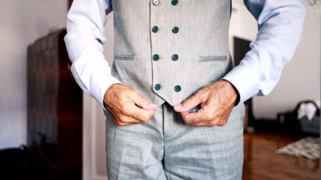 fashionable businessman getting dressed for work - adjusting stock videos & royalty-free footage