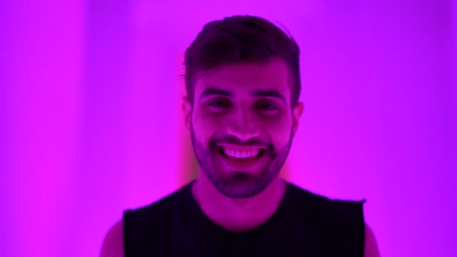 fashionable man portrait at colorful tunnel - young men stock videos & royalty-free footage