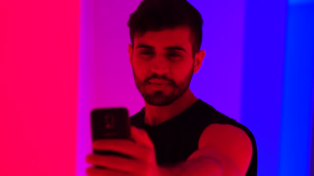 Fashionable Man Taking a Selfie at Colorful Tunnel