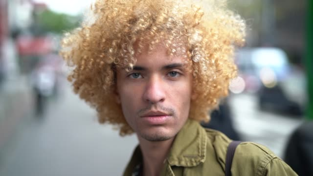 fashionable men with curly hair portrait - curly stock videos & royalty-free footage