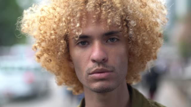 fashionable men with curly hair portrait - cool attitude stock videos & royalty-free footage
