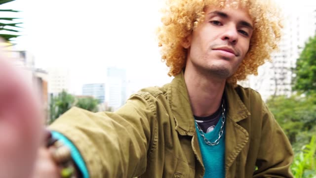fashionable men with curly hair taking a selfie - fashionable stock videos & royalty-free footage