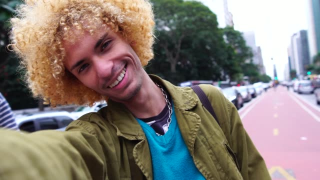 fashionable men with curly hair taking a selfie - blogging stock videos & royalty-free footage