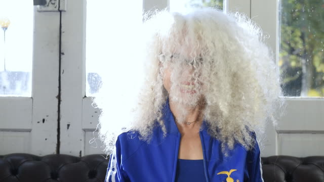 fashionable senior woman shaking hair - fashionable stock videos & royalty-free footage