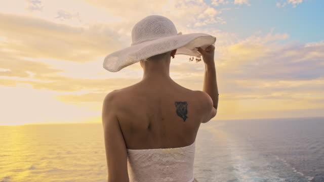 SLO MO Fashionable woman enjoying a breeze on the sea