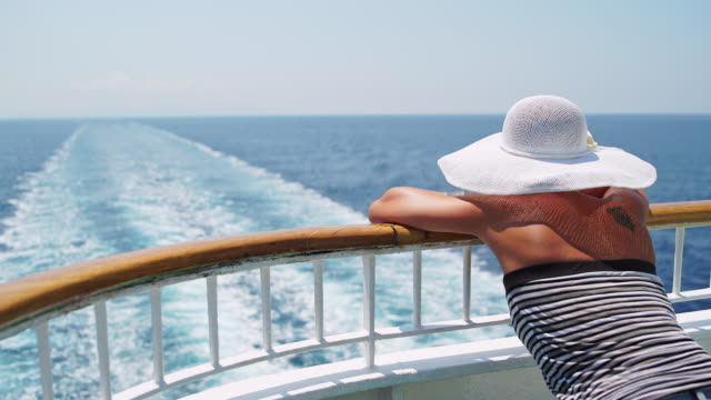 Fashionable woman enjoying a view on the cruise ship