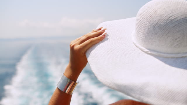 fashionable woman enjoying summer breeze on the cruise ship - viewpoint stock videos & royalty-free footage
