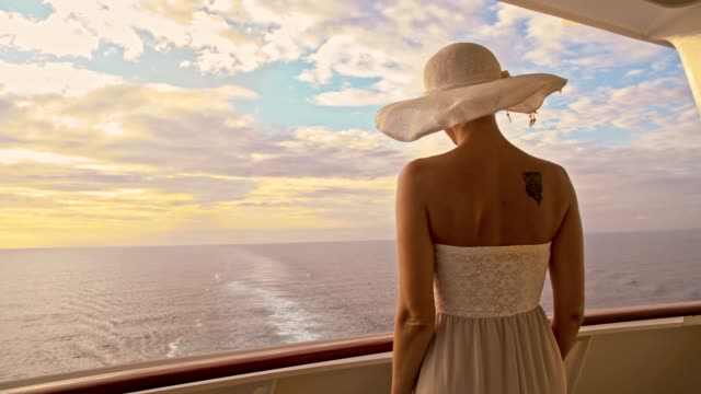 slo mo fashionable woman enjoying summer breeze on the sea - one young woman only stock videos & royalty-free footage