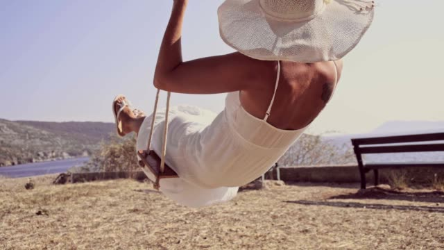 slo mo fashionable woman enjoys swinging - rope swing stock videos & royalty-free footage