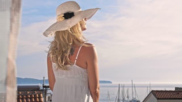 SLO MO Fashionable woman enjoys the sun