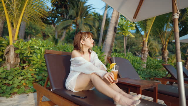 fashionable woman relaxing on the beach. - beach holiday stock videos & royalty-free footage