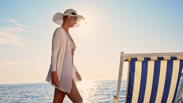 SLO MO Fashionable woman walking on the beach