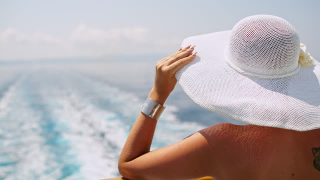 fashionable woman with white sun hat on the ferry - sun hat stock videos & royalty-free footage