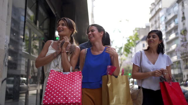 fashionable women gossiping and having fun shopping - spending money stock videos & royalty-free footage