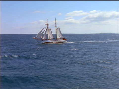 fast aerial around schooner sailing on ocean / aero, denmark - 1997 stock videos & royalty-free footage