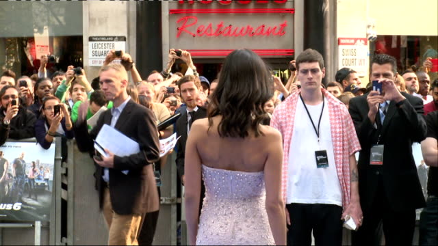 'fast and furious' film premiere: arrivals; fans behing barriers / back view actress jordana brewster posing for press then along to sign autographs... - jordana brewster stock videos & royalty-free footage