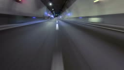 Fast driving at a empty tunnel.Vehicle shot