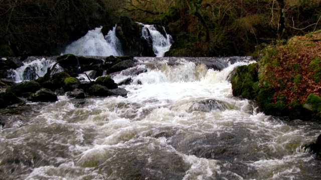 Fast flowing water and waterfalls in rural Scotland