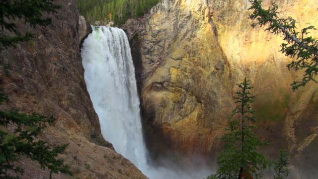 Fast Flowing Waterfall At Yellowstone Park